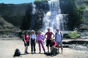 Hikers enjoying the cool spray of Alamere Falls.